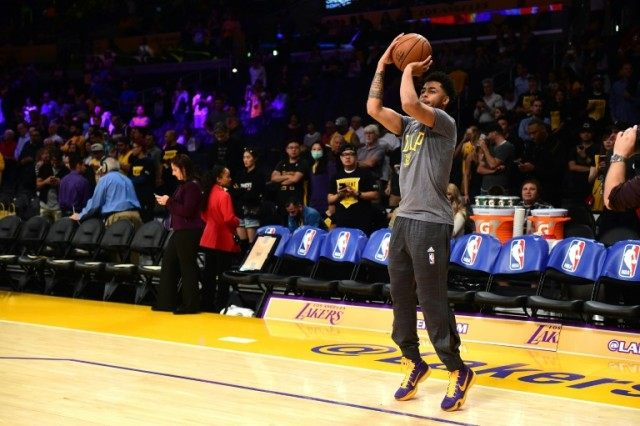 D'Angelo Russell #1 of the Los Angeles Lakers warms up for the season opening game against the Minnesota Timberwolves at Staples Center on October 28, 2015 in Los Angeles, California