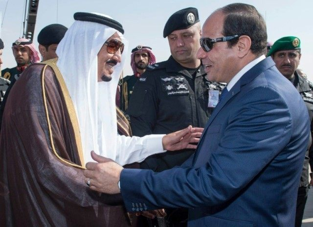 Saudi King Salman (L) greeting Egyptian Presideny Abdel Fattah al-Sisi following the latter's arrival at the King Khalid International airport in Riyadh on November 10, 2015