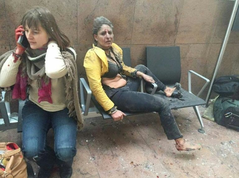 Nidhi Chaphekar (right) looks on following twin blasts at Zaventem Airport in Brussels, on March 22, 2016