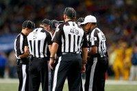 Referees discuss a call in the second quarter of a football game -- the NFL will test a new rule in 2016 under which players will be ejected from games if they receive two unsportsmanlike conduct penalties