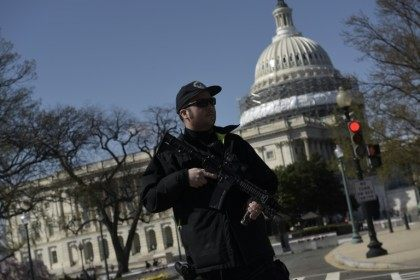 A police officer stands guard at the US Capitol complex in Washington, DC on March 28, 2016 after reports of shots fired