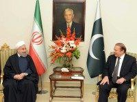 Pakistan's Prime Minister Nawaz (R) speaks with Iranian President Hassan Rouhani at the Prime Minister's House in Islamabad on March 25, 2016