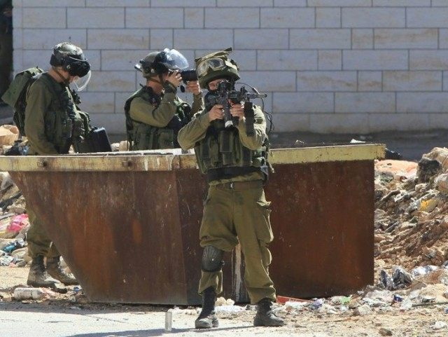 Israeli security forces in the Israeli occupied West Bank city of Hebron