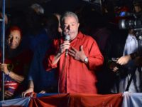 Former Brazilian President Luiz Inacio Lula da Silva participates in a rally of Unionists and members of the Workers Party (PT) to support him, in downtown Sao Paulo, Brazil on March 18, 2016