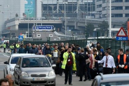 Passengers are evacuated from Brussels airport in Zaventem, on March 22, 2016, after twin blasts rocked the main terminal