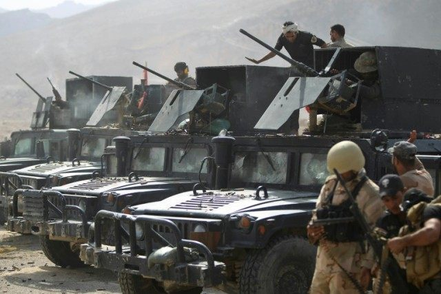 Iraqi security forces and Popular Mobilisation units, pictured in the Makhoul mountains during a military operation against Islamic State (IS) fighters in October 2015