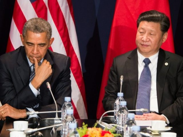 US President Barack Obama (L) sits with Chinese President Xi Jinping during a bilateral meeting ahead of the opening of the UN conference on climate change COP21 on November 30, 2015 at Le Bourget, on the outskirts of Paris