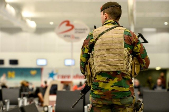 A member of military police patrols the Brussels Airport