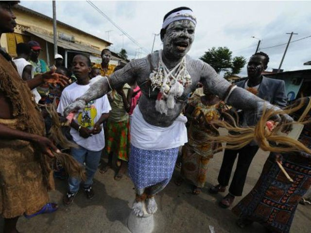 IVORY COAST, Bonoua : A witch-doctor stands on a pot on May 3, 2008 during the procession of the 30th Popo carnival of Bonoua, 60 km south of Abidjan. AFP PHOTO/ KAMBOU SIA