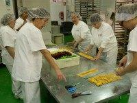 Women make 'Pan de Cadiz', a variety of turron mixed with dried fruits at the Turrones Primitivo Rovira factory on November 24, 2015 in Jijona, Spain.