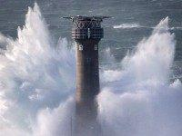 LAND'S END, UNITED KINGDOM - FEBRUARY 08: Waves crash over the Longships Lighthouse just off Land's End on February 8, 2016 in Cornwall, England. Parts of the UK are currently being battered by Storm Imogen, the ninth named storm to hit the UK this season. Thousands of homes have been …