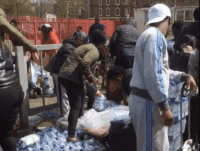 WATCH: South London Residents Pillage Cases Of Water From London Marathon Runners