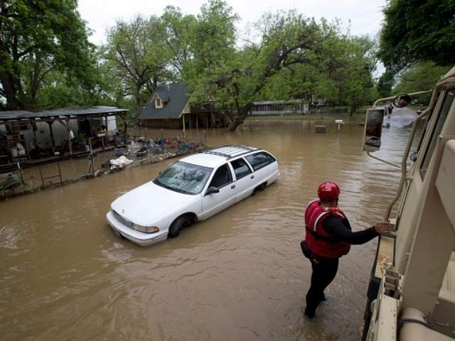 Army National Guard vehicles allow rescue workers to check on the welfare of residents who decided to stay in their homes during Brazos River flooding in the Horseshoe Bend area of Parker County, Texas, on Tuesday, April 19, 2016. (Joyce Marshall/Fort Worth Star-Telegram/TNS)