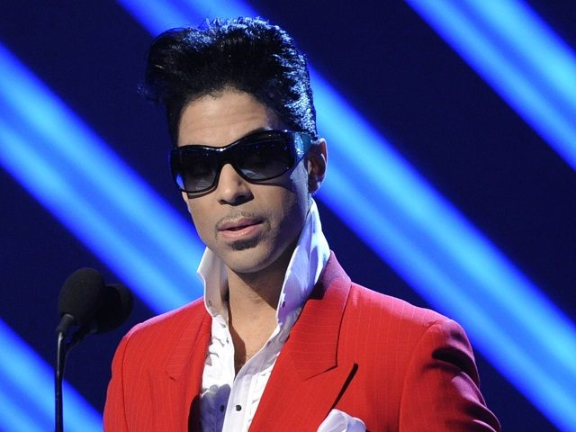 "** FILE ** In this Feb. 10, 2008 file photo, Prince appears on stage at the 50th Annual Grammy Awards in Los Angeles. A perfume company is claiming that Prince and his music publisher failed to honor a contract to help market a fragrance named for the album ""3121."" The breach-of-contract lawsuit was filed by Revelations Perfume and Cosmetics Inc. in New York. (AP Photo/Kevork Djansezian)"