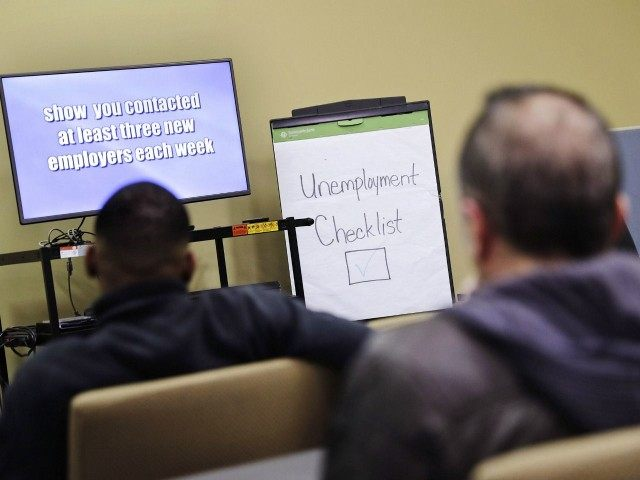 FILE - In this Thursday, March 3, 2016, file photo, people attend an employment orientation class at the Georgia Department of Labor office in Atlanta.