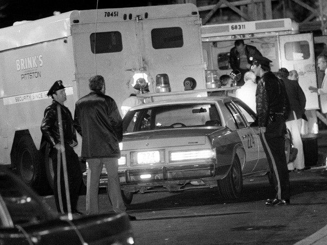 FILE - In this Oct. 21, 1981, file photo, police are at the scene of a Brinks armored truck robbery at the Nanuet Mall in Nanuet, N.Y., where multiple Nyack police officers and a Brinks guard were killed earlier during the robbery. After more than 30 years behind bars Mutulu …