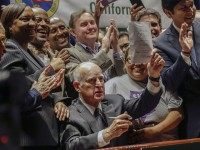 California Gov. Jerry Brown lifts a signed bill creating highest statewide minimum wage at $15 an hour by 2022 at the Ronald Reagan building in Los Angeles, Monday, April 4, 2016. California and New York acted Monday to gradually push their statewide minimum wages to $15 an hour, the highest level in the nation(AP Photo/Nick Ut)