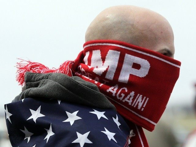 Anthony Gravitte of Geneva, N.Y., waits for a Donald Trump rally to begin on Sunday, April 10, 2016, in Rochester, N.Y. (AP Photo/Mike Groll)