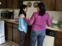 In this photo taken March 31, 2016, Teresa Garcia, right, helps her daughter, Alondra Miranda, 11, in Federal Way, Wash. Garcia has spent 14 years in the United States illegally after staying beyond the expiration of her tourist visa in 2002.