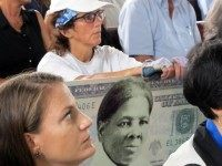 FILE - In this Monday, Aug. 31, 2015, file photo, a woman holds a sign supporting Harriet Tubman for the $20 bill during a town hall meeting at the Women's Rights National Historical Park in Seneca Falls, N.Y. A Treasury official said Wednesday, April 20, 2016, that Secretary Jacob Lew …