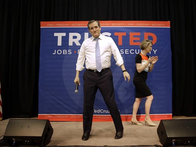 Republican presidential candidate, Sen. Ted Cruz, R-Texas stands onstage after being introduced by former candidate Carly Fiorina, during a rally in Towson, Md., Monday, April 18, 2016. (AP Photo/Patrick Semansky)