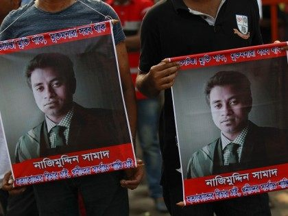 People carry portraits of student activist Nazimuddin Samad as they attend a rally to demand arrest of three motorcycle-riding assailants who hacked and shot Samad to death, in Dhaka, Bangladesh, Friday, April 8, 2016. Police suspect 28-year-old Samad was targeted for his outspoken atheism in the Muslim majority country and …