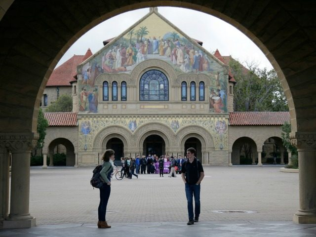 Students walk on campus at Stanford University Wednesday, Jan. 13, 2016, in Stanford, Calif.