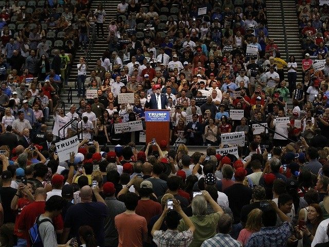 Trump speaks during a campaign rally Saturday, March 19, 2016, in Tucson, Ariz. (AP Photo/Ross D. Franklin)