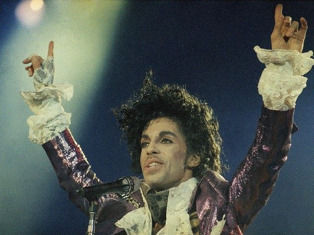 Rock singer Prince performs at the Forum in Inglewood, Calif., during his opening show, Feb. 18, 1985. (AP Photo/Liu Heung Shing)