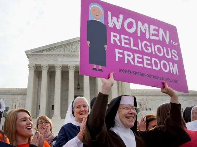 In this March 23, 2016 file photo, nuns and their supporters rally outside the Supreme Court in Washington as the court hears arguments to allow birth control in healthcare plans in the Zubik vs. Burwell case. A seemingly divided Supreme Court is exploring a possible compromise ruling in the dispute …