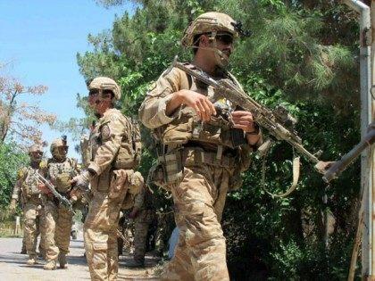 Afghan army soldiers patrol in Lashkar Gah, Helmand province.