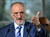 Ambassador to the United Nations and Head of the Government delegation Bashar al-Jaafari gestures during a press conference following a new round of negotiations of peace talks on Syria at the United Nations Office in Geneva on March 21, 2016.