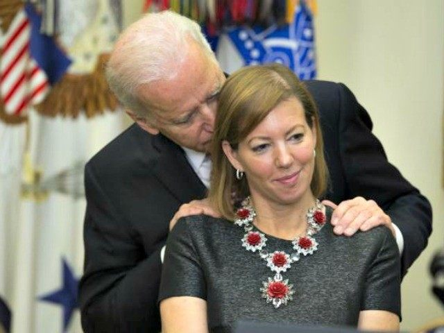 Biden Whispers to Ash Carter's Wife Evan Vucci AP