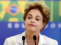BRAZIL, Brasília : TOPSHOT - Brazilian President Dilma Rousseff gestures during the Education in Defense of Democracy event, at the Planalto Palace in Brasilia, on April 12, 2016. Rousseff entered the final straight Tuesday of a desperate battle to save her presidency ahead of an impeachment vote in Congress this weekend. / AFP PHOTO / EVARISTO SA