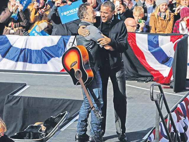U.S. President Barack Obama is introduced by singer Bruce Springsteen before he speaks at an event in Madison, Wisconsin, on his last day of campaigning, November 5, 2012. (Reuters)