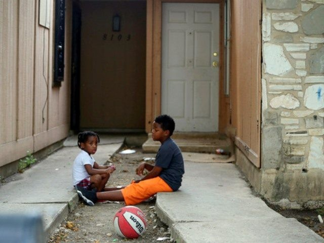 toddlers chained in back yard