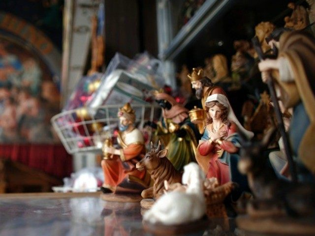 File -- a Christmas manger displayed in front of a Christian souvenir shop.