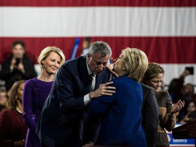 Democratic Presidential Candidate Hillary Clinton speaks with New York City Mayor Bill de Blasio during a rally at the Javits Center following Super Tuesday on March 2, 2016 in New York City.