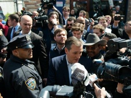 Republican presidential candidate Ted Cruz speaks to the media outside the restaurant Sabrosura 2 on April 6, 2016 in the Bronx borough of New York City.