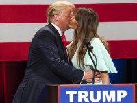 Donald Trump kisses Melania Trump (Darren Hauck / Getty)