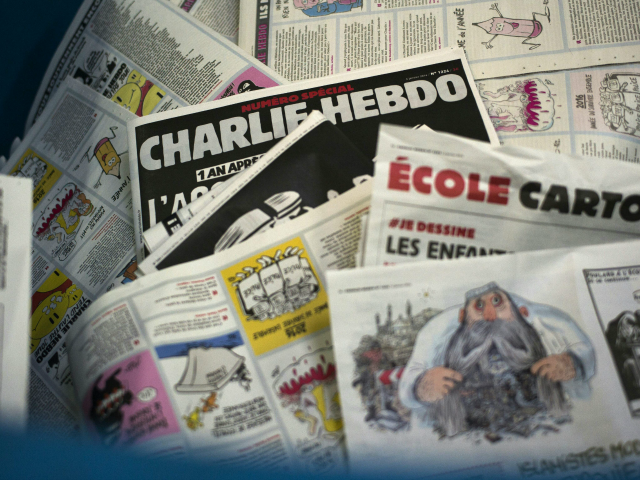 A picture taken on January 4, 2016 at a printing house near Paris shows the cover of the latest edition of the French Satirical magazine Charlie Hebdo bearing a headline which translates as 'One year on: The assassin still at large' in an edition to mark the first anniversary of …
