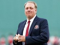 Former Boston Red Sox pitcher Curt Schilling #38 throws out the first pitch after being inducted into the Red Sox Hall of Fame prior to the game against the Minnesota Twins during the game on August 3, 2012 at Fenway Park in Boston.