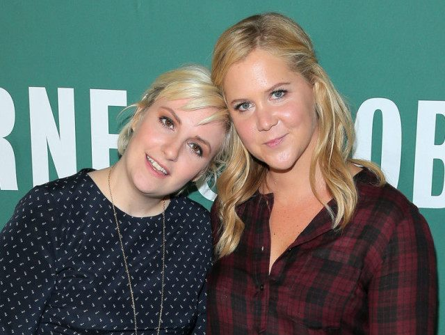 """NEW YORK, NY - SEPTEMBER 30: Author/comedian Lena Dunham and actress/comedian Amy Schumer pose for a photo at the book signing for Lena Dunham's book """"Not That Kind of Girl: A Young Woman Tells You What She's """"Learned"""" at Barnes & Noble Union Square on September 30, 2014 in New …"""