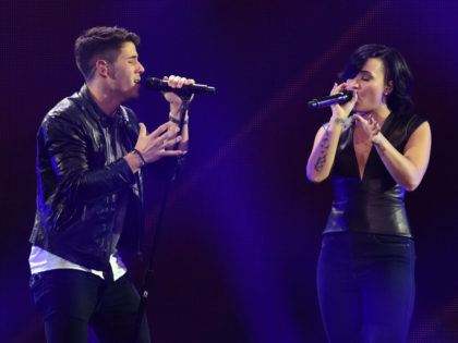 LOS ANGELES, CA - DECEMBER 05: Host Nick Jonas (L) and recording artist/actress Demi Lovato perform onstage during KIIS FM's Jingle Ball 2014 powered by LINE at Staples Center on December 5, 2014 in Los Angeles, California. (Photo by Kevin Winter/Getty Images for iHeartMedia)