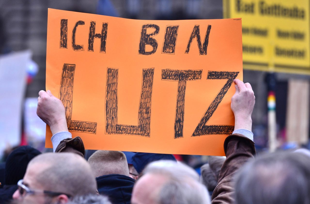 A sympathizers of German right-wing populist movement PEGIDA (Patriotic Europeans Against the Islamisation of the Occident)'s former leader Lutz Bachmann holds a poster reading 'I am Lutz' during a march in Dresden, eastern Germany on January 25, 2015. Hours before a new rally in Dresden by the Islamophobic movement PEGIDA on Sunday, German Foreign Minister Frank-Walter Steinmeier said the group's anti-Muslim sentiments were harming the nation's image abroad. AFP PHOTO / JOHN MACDOUGALL (Photo credit should read JOHN MACDOUGALL/AFP/Getty Images)