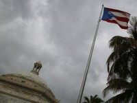 The Puerto Rican flag flies near the Capitol building as the island's residents deal with the government's $72 billion debt on July 1, 2015 in San Juan, Puerto Rico.