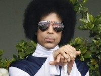 US singer Prince attends the French tennis Open round of sixteen match between Spain's Rafael Nadal and Serbia's Dusan Lajovic at the Roland Garros stadium in Paris on June 2, 2014. AFP PHOTO / PATRICK KOVARIK (Photo credit should read PATRICK KOVARIK/AFP/Getty Images)