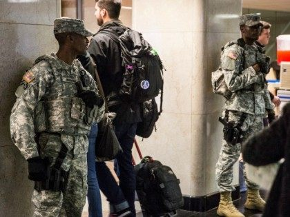 Members of the National Guard watch over Thanksgiving travelers at Penn Station on November 25, 2015 in New York, United States.