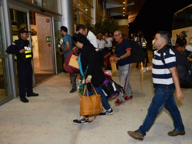 Cuban immigrants arrive January 12, 2016 at the airport of the Costa Rican city of Liberia, 198 kms north of the capital, for a flight to El Salvador. This is the first of up to 28 flights out of Costa Rica that will allow 7,800 stranded Cubans to continue their …