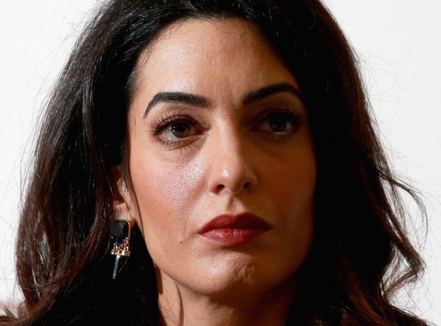 amal clooney slams trump building walls doesn t
